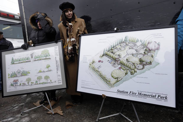 Diane Gomes, of Johnston, R.I., left, and Elaine Grant, of Lincoln, R.I., center, help display artist's renderings of a planned permanent memorial for victims of The Station nightclub fire during ceremonies at the site of the fire, in West Warwick, R.I., Sunday, Feb. 17, 2013. The 2003 blaze, which broke out when pyrotechnics for the rock band Great White ignited flammable packing foam that had been installed inside the club as soundproofing, took the lives of 100 people. (AP Photo/Steven Senne)