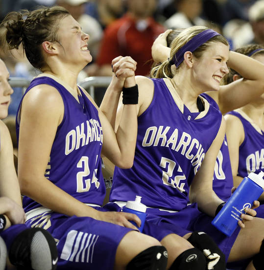 Okarche's Madison Lee (24) and Kenadey Grellner (22) celebrate on the bench in the final minutes of a Class A Girls semifinal game of the state high school basketball tournament between Okarche and Turner at Jim Norick Arena, The Big House, on State Fair Park in Oklahoma City, Friday, March 1, 2013.Okarche won, 62-24. Photo by Nate Billings, The Oklahoman