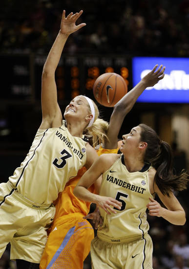 Vanderbilt forward Heather Bowe (3) and guard Kady Schrann (5) battle with Tennessee forward Jasmine Jones, rear, for a rebound in the first half of an NCAA college basketball game, Thursday, Jan. 24, 2013, in Nashville, Tenn. (AP Photo/Mark Humphrey)