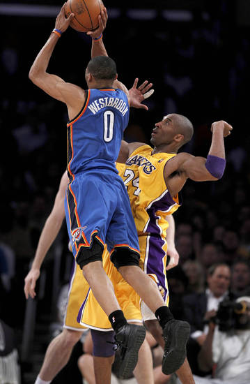 Oklahoma City Thunder guard Russell Westbrook, left, shoots past Los Angeles Lakers guard Kobe Bryant during the first half of Game 5 of a first-round NBA basketball playoff series, in Los Angeles, Tuesday, April 27, 2010. (AP Photo/Chris Carlson) ORG XMIT: LAS105