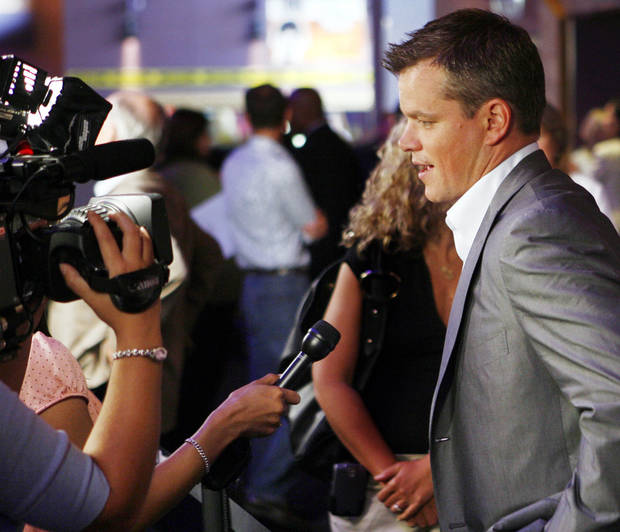 "Actor Matt Damon answers question before the Oklahoma City premiere of ""The Bourne Ultimatum""  at the Harkins Bricktown Theaters in Oklahoma City, Tuesday, July 31, 2007.  Damon and producer Frank Marshall brought the film to benefit The Children's Center. By Nate Billings, The Oklahoman"