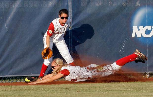 Alabama's Jazlyn Lunceford (2) dives for a ball as Jennifer Fenton (7) looks on during the Women's College World Series game between Flordia and Alabama at the ASA Hall of Fame Stadium in Oklahoma City, Sunday, June 5, 2011. Photo by Garett Fisbeck, The Oklahoman