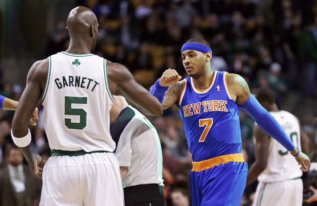 Boston Celtics forward Kevin Garnett (5) and New York Knicks forward Carmelo Anthony (7) meet at center court before the opening tip of their NBA basketball game in Boston, Thursday, Jan. 24, 2013. (AP Photo/Charles Krupa)
