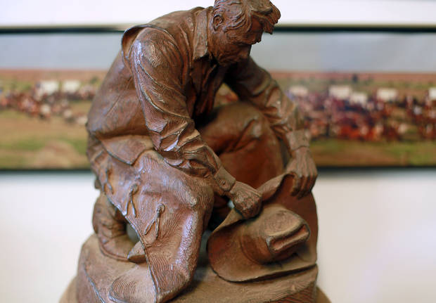 A small copy of Harold Holden's memorial bronze at Oklahoma State University sits surrounded by other projects inside Harold Holden's studio in Kremlin, Okla., on Thursday, Jan. 20, 2011. Photo by John Clanton, The Oklahoman