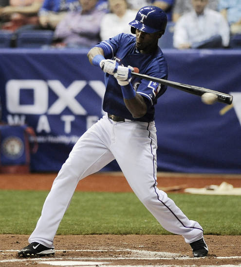 Texas Rangers' Julio Borbon tips a pitch during an exhibition baseball game against the San Diego Padres, Saturday, March 30, 2013, at the Alamodome in San Antonio. (AP Photo/Darren Abate)