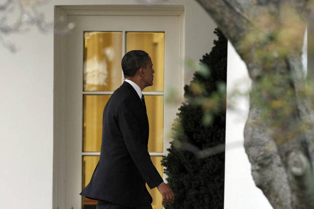 <p>President Barack Obama enters the Oval Office on his return to the White House after visiting Superstorm Sandy effected parts of New York, in Washington on Thursday, Nov. 15, 2012. (AP Photo/Jacquelyn Martin)</p>