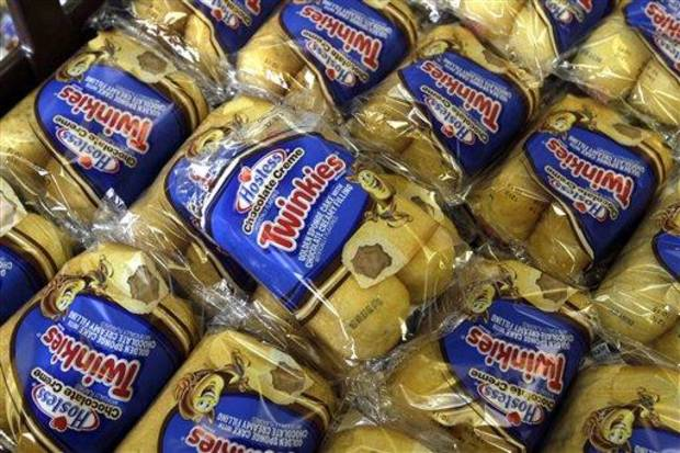 FILE - In this Friday, Nov. 16, 2013, file photo, Twinkies baked goods are displayed for sale at the Hostess Brands&#039; bakery in Denver, Colo. Hostess Brands is close to announcing that it has picked two investment firms, C. Dean Metropoulos &amp; Co. and Apollo Global Management,  as the lead bidders for its Twinkies and other snack cakes, according to a source close to the situation. (AP Photo/Brennan Linsley, File)