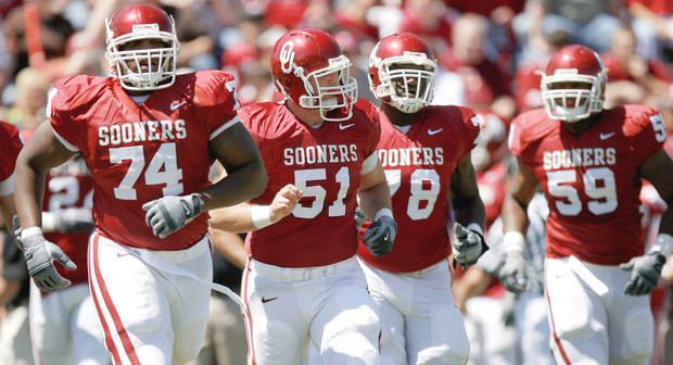 OU offensive linemen Brian Simmons, left, Brian Lepak and Alex Williams walk toward the ball before a play during Saturday's Red-White game. The offensive line remains a question mark for the Sooners. Photo by Bryan Terry, The Oklahoman