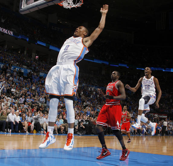 Oklahoma City's Russell Westbrook (0) and Kevin Durant (35) celebrate a dunk in front of Chicago's Luol Deng (9) during the NBA basketball game between the Chicago Bulls and the Oklahoma City Thunder at Chesapeake Energy Arena in Oklahoma City, Sunday, April 1, 2012. Photo by Sarah Phipps, The Oklahoman