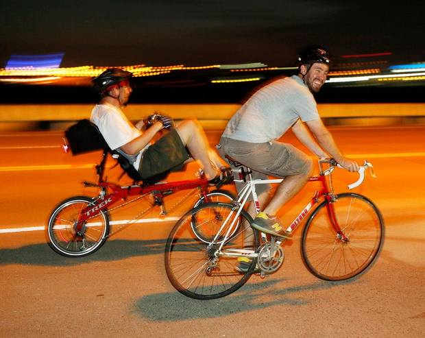 Cyclists ride over the Lincoln bridge during the Full Moon Bicycle Ride organized by the Myriad Gardens and Schlegel Bicycles in Oklahoma City, Monday, July 22, 2013. Photo by Nate Billings, The Oklahoman