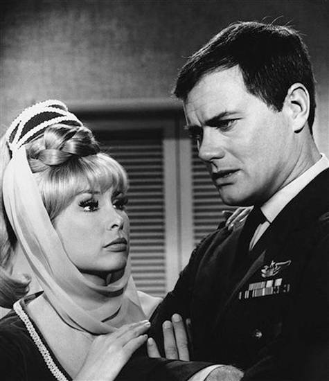   FILE - This 1967 file photo shows Barbara Eden, left, and Larry Hagman in a scene from the television show &quot;I Dream of Jeannie.&quot; Actor Larry Hagman, who for more than a decade played villainous patriarch JR Ewing in the TV soap Dallas, has died at the age of 81, his family said Saturday Nov. 24, 2012. (AP Photo/NBC, file)  