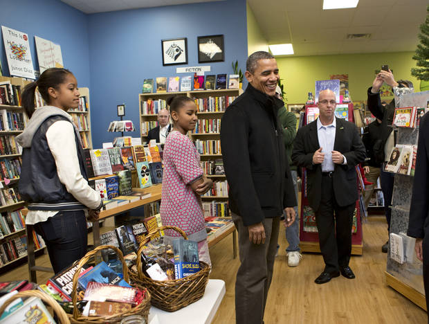 President Barack Obama, with daughters Sasha, left, and Malia, center, goes shopping at a small bookstore, One More Page, in Arlington, Va., Saturday, Nov. 24, 2012. (AP Photo/J. Scott Applewhite)