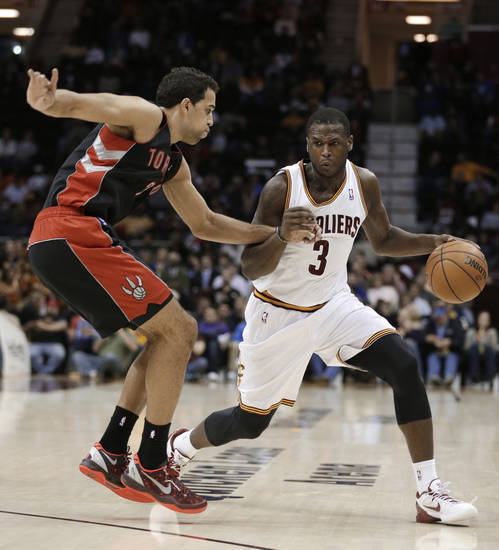 Cleveland Cavaliers' Dion Waiters (3) drives past Toronto Raptors' Landry Fields (2) during the second quarter of an NBA basketball game Wednesday, Feb. 27, 2013, in Cleveland. Waiters scored a team-high 23 points in the Cavaliers' 103-92 win. (AP Photo/Tony Dejak)