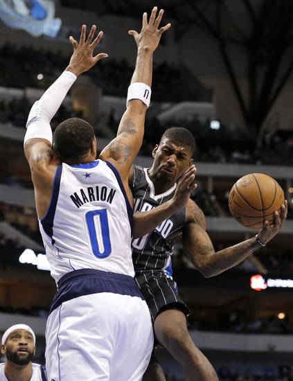 Dallas Mavericks' Shawn Marion (0) defends as Orlando Magic's DeQuan Jones (20) looks for a shot during the first half of an NBA basketball game Wednesday, Feb. 20, 2013, in Dallas. (AP Photo/Tony Gutierrez)