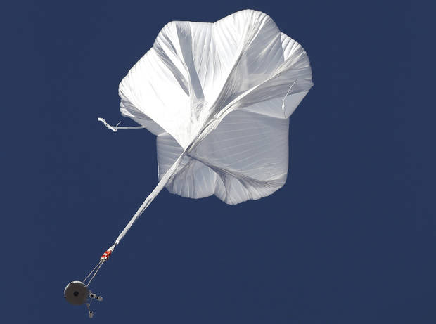 The capsule and attached helium balloon carrying Felix Baumgartner lifts off as he attempts to break the speed of sound with his own body by jumping from a space capsule lifted by a helium balloon, Sunday, Oct. 14, 2012, in Roswell, N.M.  Baumgartner plans to jump from an altitude of 120,000 feet, an altitude chosen to enable him to achieve Mach 1 in free fall, which would deliver scientific data to the aerospace community about human survival from high altitudes.(AP Photo/Ross D. Franklin) ORG XMIT: NMRF113