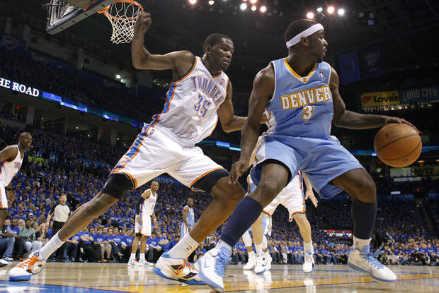 Oklahoma City's Kevin Durant (35) defends on Denver's Ty Lawson (3) during the first round NBA playoff game between the Oklahoma City Thunder and the Denver Nuggets on Sunday, April 17, 2011, in Oklahoma City, Okla. Photo by Chris Landsberger, The Oklahoman