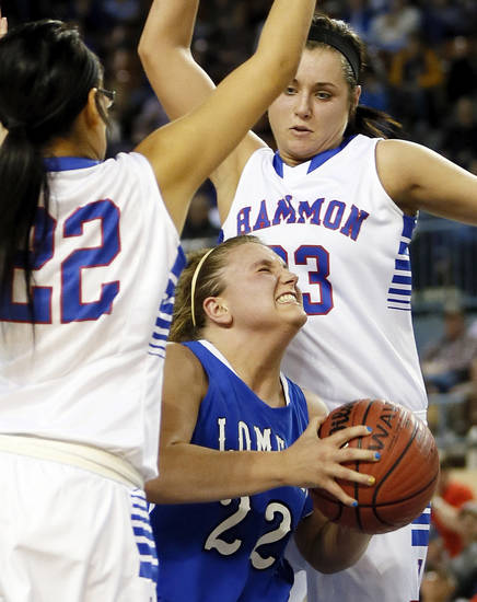 Lomega's Ashley LaGasse (22) tries to drive between Hammon's Peyton Walker (23) and Jamie Highwalker (22) during a Class B Girls semifinal game of the state high school basketball tournament between Hammon and Lomega at Jim Norick Arena, The Big House, on State Fair Park in Oklahoma City, Friday, March 1, 2013. Photo by Nate Billings, The Oklahoman