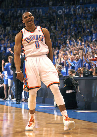 Oklahoma City&#039;s Russell Westbrook (0) celebrates a three-point shot during game one of the first round in the NBA playoffs between the Oklahoma City Thunder and the Dallas Mavericks at Chesapeake Energy Arena in Oklahoma City, Saturday, April 28, 2012. Photo by Sarah Phipps, The Oklahoman