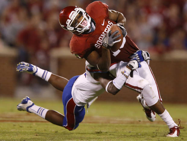 OU's Justin Brown (19) makes a catch in front of KU's Greg Brown (5) during the college football game between the University of Oklahoma Sooners (OU) and the Kansas Jayhawks (KU) at Gaylord Family-Oklahoma Memorial Stadium in Norman, Okla., Saturday, Oct. 20, 2012. Photo by Bryan Terry, The Oklahoman