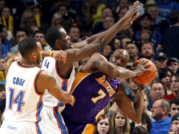 Oklahoma City's Daequan Cook (14) and Serge Ibaka (9) pressure Lakers' Lamar Odom (7) during the NBA basketball game between the Oklahoma City Thunder and the Los Angeles Lakers, Sunday, Feb. 27, 2011, at the Oklahoma City Arena.Photo by Sarah Phipps, The Oklahoman