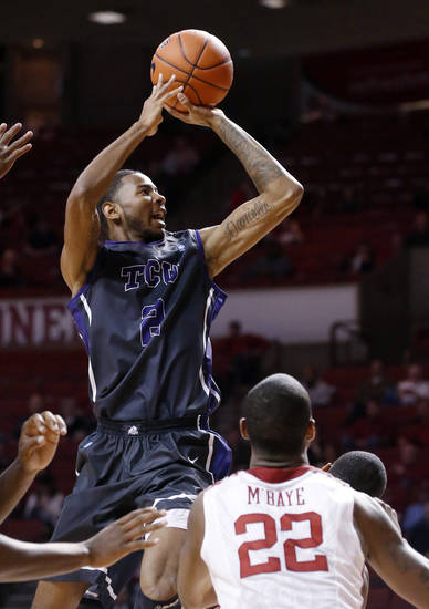 TCU forward Connell Crossland (2) shoots in front of Oklahoma forward Amath M'Baye (22) in the first half of an NCAA college basketball game in Norman, Okla., Monday, Feb. 11, 2013. (AP Photo/Sue Ogrocki)