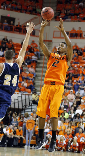 Oklahoma State's Le'Bryan Nash (2) shoots over UC Davis' Ryan Howley (24) during the men's college basketball game between Oklahoma State and UC Davis at  Gallagher-Iba Arena in Stillwater, Okla., Friday, Nov. 9, 2012. Photo by Sarah Phipps, The Oklahoman