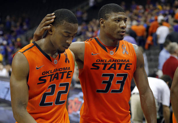 Oklahoma State's Marcus Smart (33) consoles Markel Brown (22) as they walk off the court following the Phillips 66 Big 12 Men's basketball championship tournament game between Oklahoma State University and Kansas State at the Sprint Center in Kansas City, Friday, March 15, 2013. Photo by Sarah Phipps, The Oklahoman