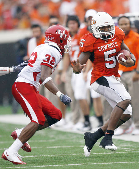 OSU's Keith Toston, right, is run out of bounds by Houston's Jamal Robinson during Saturday's game.  Photo by Sarah Phipps, The Oklahoman