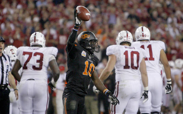 Oklahoma State's Markelle Martin (10) celebrates a fumble recovery during the Fiesta Bowl between the Oklahoma State University Cowboys (OSU) and the Stanford Cardinal at the University of Phoenix Stadium in Glendale, Ariz., Monday, Jan. 2, 2012. Photo by Sarah Phipps, The Oklahoman