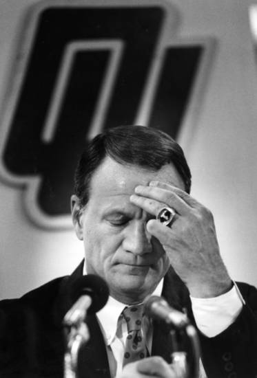 Barry Switzer pauses after announcing his resignation, effective immediately, as head coach of the University of Oklahoma Sooners on June 19, 1989. Photo by Steve Sisney, The Oklahoman