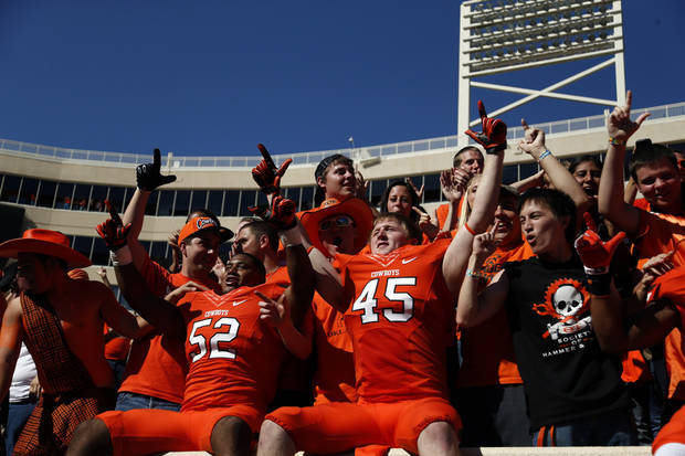 Oklahoma State's Ryan Simmons (52) and Caleb Lavey (45) celebrate with fans following a college football game between Oklahoma State University (OSU) and Iowa State University (ISU) at Boone Pickens Stadium in Stillwater, Okla., Saturday, Oct. 20, 2012. Photo by Sarah Phipps, The Oklahoman