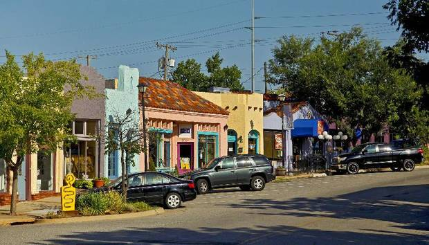 The Paseo Arts District, developed over three decades by John Belt, is home to galleries, shops, restaurants and bars. By Chris Landsberger, The Oklahoman Archives.