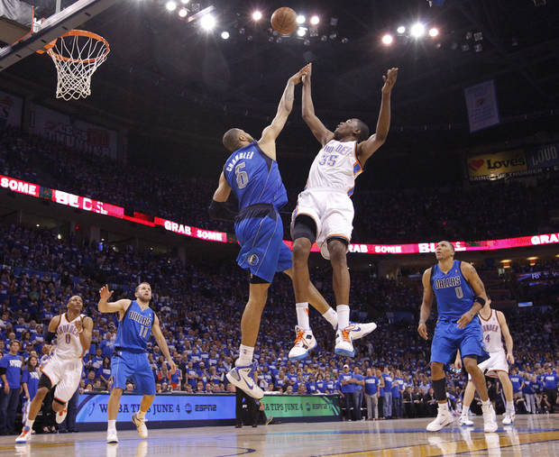 Oklahoma City's Kevin Durant (35) shoots the ball over Tyson Chandler (6) of Dallas during game 3 of the Western Conference Finals of the NBA basketball playoffs between the Dallas Mavericks and the Oklahoma City Thunder at the OKC Arena in downtown Oklahoma City, Saturday, May 21, 2011. Photo by Chris Landsberger, The Oklahoman