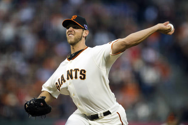 San Francisco Giants starting pitcher Madison Bumgarner works in the first inning against the Cincinnati Reds in Game 2 of the National League division baseball series, Sunday, Oct. 7, 2012, in San Francisco. (AP Photo/The Sacrament Bee, Paul Kitagaki Jr.)