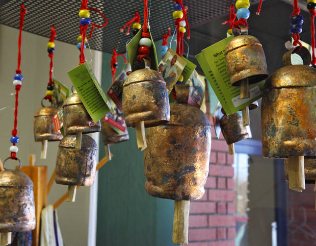 These bells from India are some of the items for sale at Pambe Ghana Global Market. Photo By David McDaniel, The Oklahoman. <strong>David McDaniel - The Oklahoman</strong>