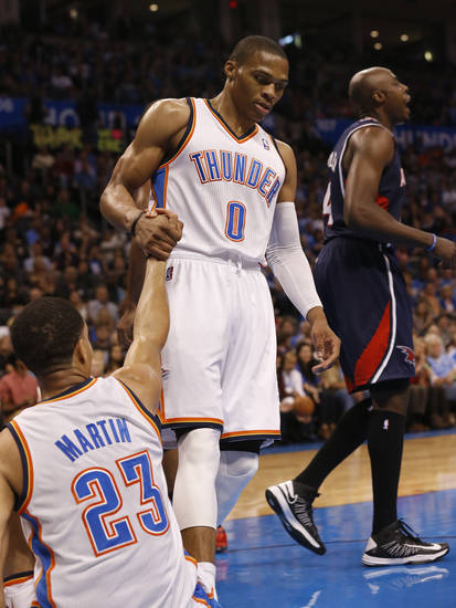 Oklahoma City Thunder's Russell Westbrook (0) helps Kevin Martin (23) up after a shot and foul as the Oklahoma City Thunder play the Atlanta Hawks in NBA basketball at the Chesapeake Energy Arena in Oklahoma City, on Sunday, Nov. 4, 2012.  Photo by Steve Sisney, The Oklahoman