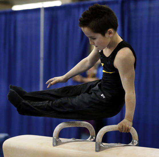 Kaden Bowling, 9, from Springfield, Mo. competes on the pommel horse at the Bart Connor Invitational Sports Festival on Saturday, Feb. 16, 2013  in Oklahoma City, Okla. Photo by Steve Sisney, The Oklahoman