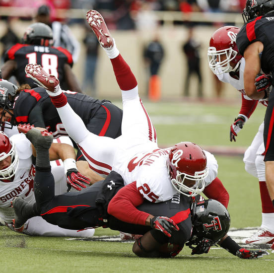 Oklahoma's Aaron Franklin (25) brings down Texas Tech's SaDale Foster (8) during a college football game between the University of Oklahoma (OU) and Texas Tech University at Jones AT&T Stadium in Lubbock, Texas, Saturday, Oct. 6, 2012. Oklahoma won 41-20. Photo by Bryan Terry, The Oklahoman
