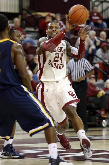 Oklahoma's Romero Osby (24) passes the ball as the University of Oklahoma (OU) Sooners men's basketball team defeats  the Central Oklahoma Bronchos 94-66 at McCasland Field House on Wednesday, Nov. 7, 2012  in Norman, Okla. Photo by Steve Sisney, The Oklahoman