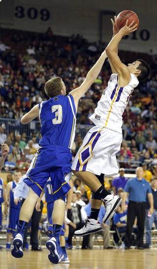 Weleetka's Jackson Frye shoots a lay up over Glencoe's Kagen Castlebury  during the Class A boys state championship between Glencoe and Weleetka  at the State Fair Arena., Saturday, March 2, 2013. Photo by Sarah Phipps, The Oklahoman