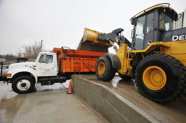 Salt trucks are loaded at the municipal facility in SW Oklahoma City, Thursday, Jan. 28, 2010. By Paul Hellstern, The Oklahoman