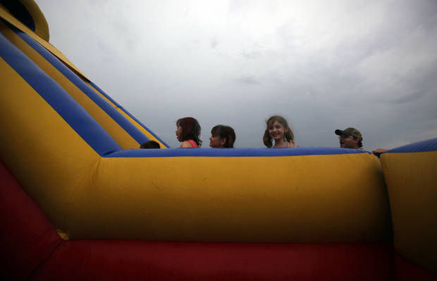 Children line up to climb a ladder on a inflatable slide during the LibertyFest's ParkFest at the University of Central Oklahoma, Sunday, July 4, 2010, in Edmond, Okla. Photo by Sarah Phipps, The Oklahoman