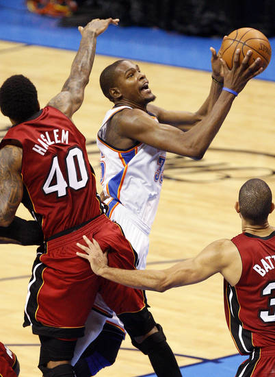 Oklahoma City's Kevin Durant (35) moves to the hoop between Miami's Udonis Haslem (40) and Shane Battier (31) in the fourth quarter during Game 1 of the NBA Finals between the Oklahoma City Thunder and the Miami Heat at Chesapeake Energy Arena in Oklahoma City, Tuesday, June 12, 2012. Oklahoma City won, 105-94. Photo by Nate Billings, The Oklahoman