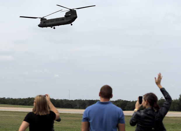 Family and friends wave good bye to soldiers following an Oklahoma Aviation Command mobilization ceremony  for Detachment 1, Company C, 2-149th General Support Aviation Battalion at the Army Aviation Support Facility in Lexington, Okla.,  Sunday, Sept. 16, 2012. The soldiers will receive additional training at Fort Hood before being deployed to Afghanistan. Photo by Sarah Phipps, The Oklahoman