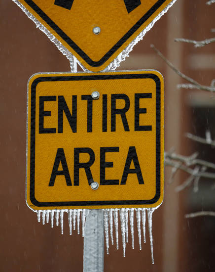 A street sign on the campus of the University of Oklahoma is covered with ice as a winter storm moves into the area on Thursday, Jan. 28, 2010, in Norman, Okla.  Photo by Steve Sisney, The Oklahoman