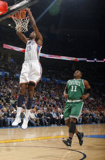Oklahoma City&#039;s Kevin Durant (35) dunks in front of Boston&#039;s Glen Davis during the NBA game between the Oklahoma City Thunder and the Boston Celtics, Sunday, Nov. 7, 2010, at the Oklahoma City Arena. Photo by Sarah Phipps, The Oklahoman