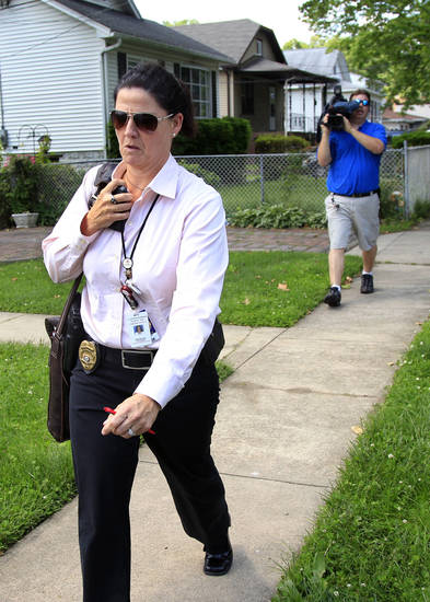 An investigator with the Camden County prosecutors office leave a residence in Maple Shade, N.J., Thursday, May 24, 2012. A woman who answered the door said that it is the home of Pedro Hernandez, who is in custody in the disappearance of Etan Patz in 1979. Hernandez has implicated himself in the death of Patz, police said Thursday. (AP Photo/Mel Evans)