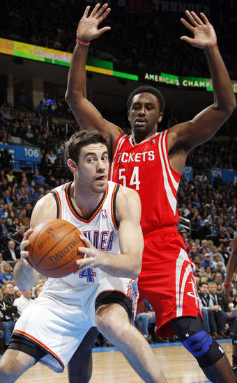 Oklahoma City's Nick Collison (4) works the ball underneath the basket as Patrick Patterson (54) defends for Houston in the first half during the NBA basketball game between the Oklahoma City Thunder and the Houston Rockets at Chesapeake Energy Arena in Oklahoma City, Friday, Jan. 6, 2012. Photo by Nate Billings, The Oklahoman