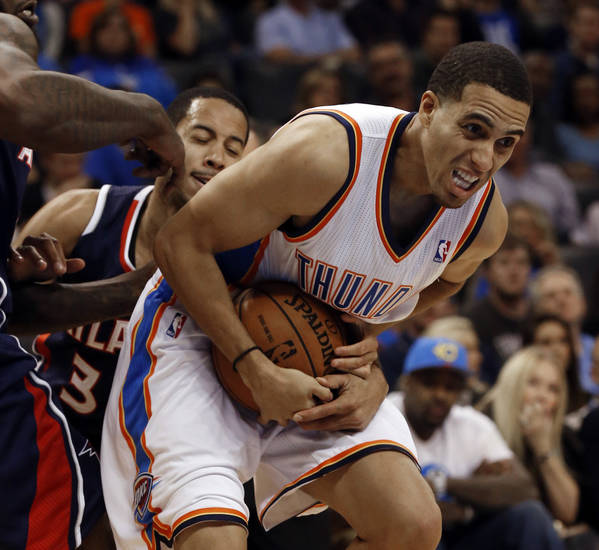 Atlanta Hawk's Devin Harris (34) reaches around Oklahoma City Thunder's Kevin Martin (23) as the Oklahoma City Thunder play the Atlanta Hawks in NBA basketball at the Chesapeake Energy Arena in Oklahoma City, on Sunday, Nov. 4, 2012.  Photo by Steve Sisney, The Oklahoman