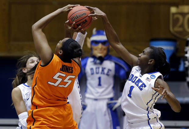 Duke's Elizabeth Williams (1) blocks Oklahoma State's LaShawn Jones (55) during the first half of a second-round game in the women's NCAA college basketball tournament in Durham, N.C., Tuesday, March 26, 2013. (AP Photo/Gerry Broome)